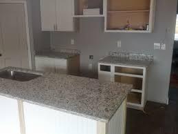kitchen kitchen islan with sink and dallas white granite