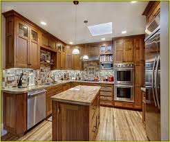Decorating Above Kitchen Cabinets Pictures by Decorating Above Kitchen Cabinets Tuscany Home Design Ideas