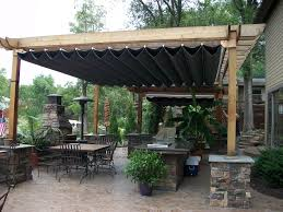 decor stone chimney design ideas combined with wooden pergola