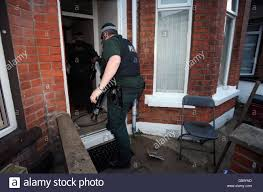 psni officers carry out a drugs raid on a house in east belfast as