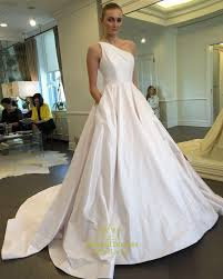 one shoulder wedding dresses simple ivory one shoulder gown wedding dress with pockets