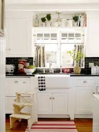 beachside cottage decorating black subway tiles red accents and