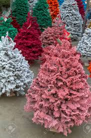 multi colored flocked christmas trees stock photo picture and