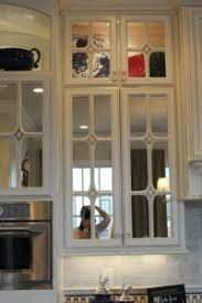 glass kitchen cabinet doors only lowes unfinished kitchen cabinets how to put glass in kitchen