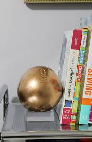 using an oversized wood pool ball to make a lucite inspired bookend