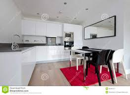 contemporary fully fitted kitchen in white royalty free stock