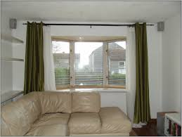 bay window rods curtain bay window with wood drapery rods use