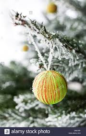 decoration hangs from a frosted pine tree stock photo