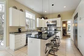 white cabinets and butcher block countertops in a small kitchen
