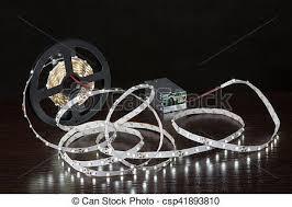 led strip light photography shining led strip light on a reel near power unit glowing stock