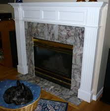 updating an old fireplace ecc remodeling refacing with new tile