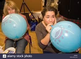 women blowing up balloons at a christmas fayre hampshire