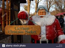 santa statue with german market sign at winter