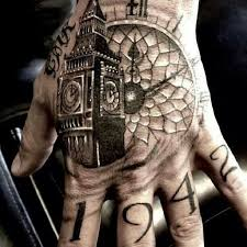 black and grey clock with big ben tattoo on hand