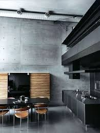 modern clean industrial style kitchen with black walls and marble