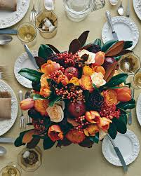 thanksgiving centerpiece with pomegranates tulips and roses