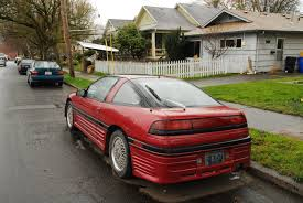 mitsubishi 90s sports car old parked cars 1990 plymouth laser
