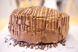moist mocha cake with chocolate drizzle and a powdered sugar