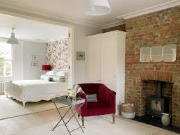 brick wallpaper bedroom bedroom transitional with red side chair