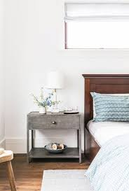 gray metal nightstand with marble lamp transitional bedroom