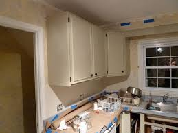 how to redo kitchen by painting cream colored cabinets with