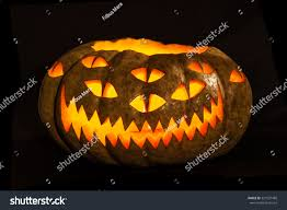traditional glowing halloween jackolantern carved unusual stock