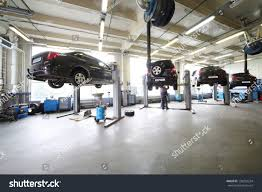 small cars black four black cars on lifts small stock photo 138252224 shutterstock