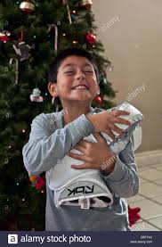 multicultural hispanic american child receives his
