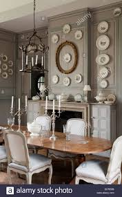 french antique chairs and table in elegant dining room with wood