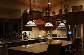 above kitchen cabinet decorating ideas kitchen how to decorate top of kitchen cabinets arzacano for ideas