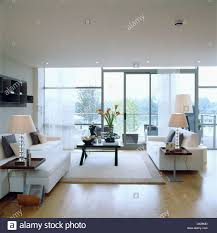 white rug and white sofas in large modern apartment living room