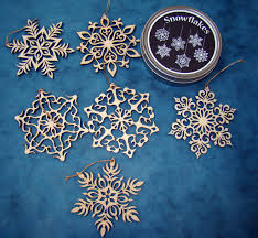adorn your tree with the delicate laser cut snowflakes cut from