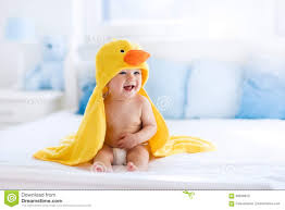 cute baby after bath in yellow duck towel stock photo image baby bath