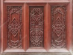 ancient art pattern on the wooden door in thailand temple u2014 stock