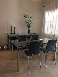 glass chrome dining table and 4 black leather chairs u2013 estate