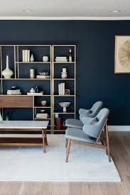 ideas about navy blue walls pinterest dark two blue mid century modern chairs sit side facing marble top coffee table positioned white wool rug front styled piece brass and