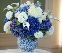 white and blue floral arrangements flowers arrangement light blue white floral arrangement in baby