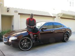 bentley burgundy frank gore of san francisco 49ers sittin on his car san