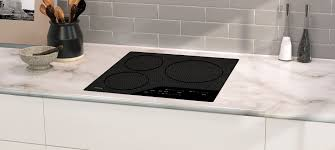 24 wolf induction cooktop three elements and bridging option to accommodate diffe pan sizes