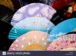 colourful japanese fans for sale in kyoto japan stock photo