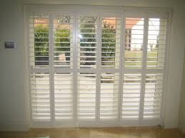 cathedral shutters and blinds tracked plantation shutters