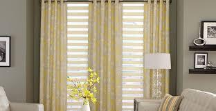 yellow blue green brown pattern window curtain scene depicting