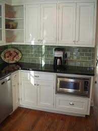 kitchen cabinet microwave built in again love the combo of cabinets tile and counters also like the