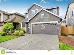 nice curb appeal of two level house mocha exterior paint and
