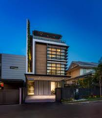 modern green wall house in singapore by adx architects pte ltd