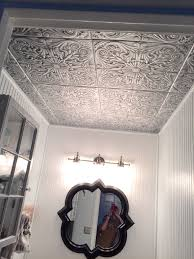 powder room bath remedy for popcorn ceiling i removed the popcorn first what a messy project but these ceiling tiles can go right over if you don t
