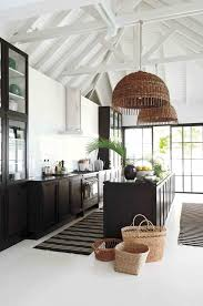 white woven pendant light breezy black and white kitchen with exposed white rafters woven