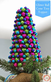 a glimpse inside glitter ball cone tree topper