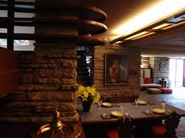 fallingwater dining area with kaufmann portrait frank lloyd wright