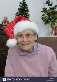 what to get an elderly woman for christmas elderly woman wearing a christmas hat stock photo 20395163